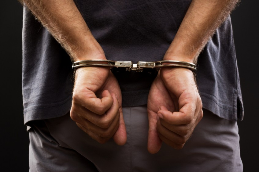 man with handcuffs behind his back