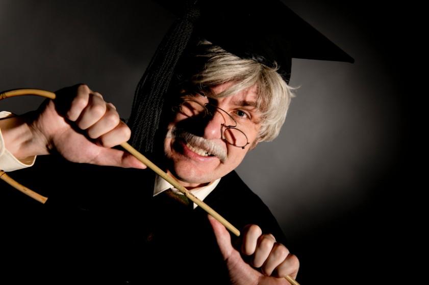 Headmaster holding cane