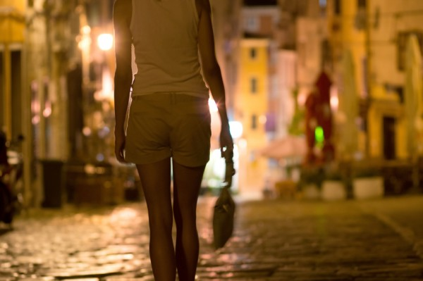 Picture of a woman's bum and a handbag walking down the street