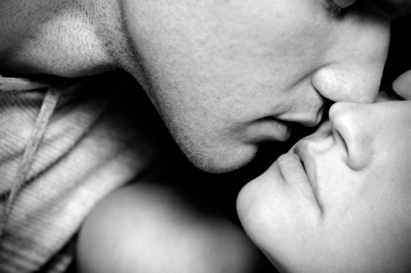 Black and white image of couple kissing