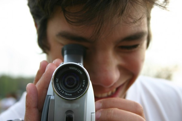 smiling mad with video camera