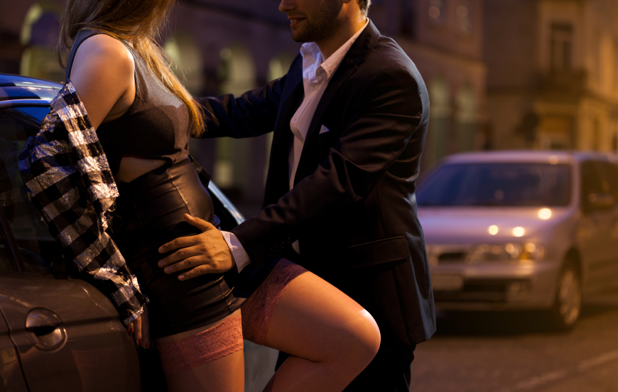 Man with prostitute near car