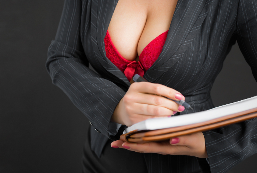 Teachers breasts covered in red bra