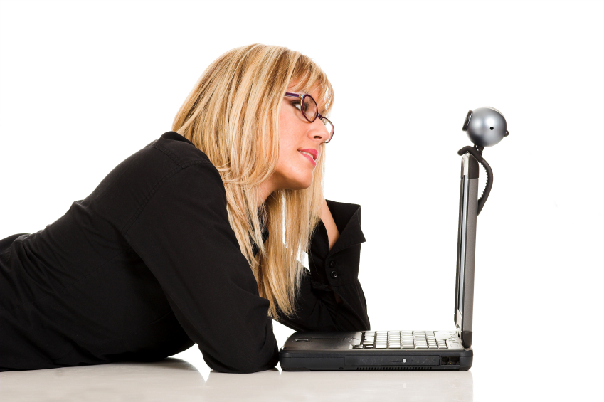 Woman looks at laptop with Skype