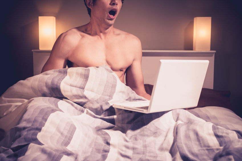 Man masturbating to laptop under bed