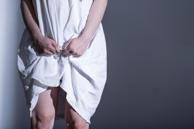 woman in white sheet after being raped