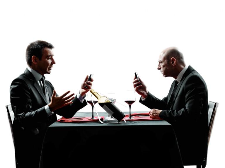 Two businessmen using phones