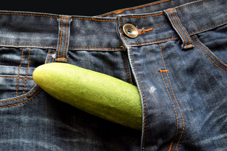 Man with cucumber coming out of his pants like a penis