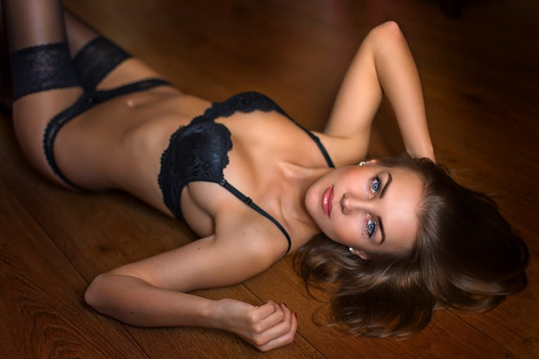 Seductive brunette model on the floor laying in underwear