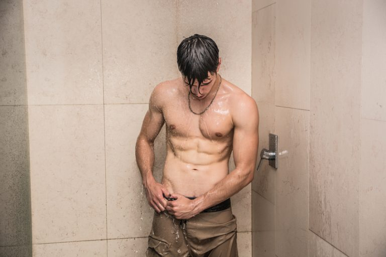 A sexy man in the shower, celebrating Men's Grooming Day