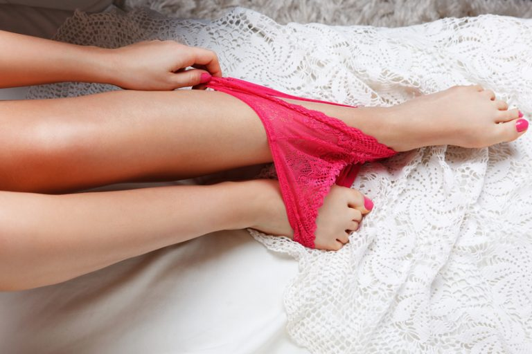 Woman with pants round her ankles