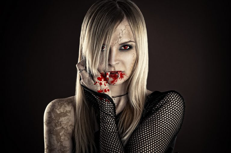 beautiful sexy vampire woman isolated on black background