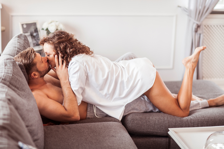 Woman on top of man on the couch