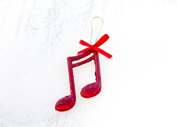 picture of a red shiny decorative christmas music notes