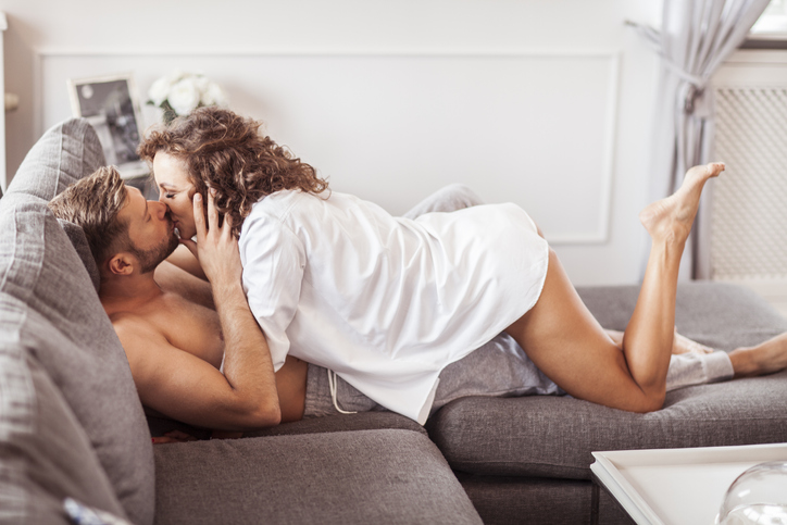 couple on sofa kissing