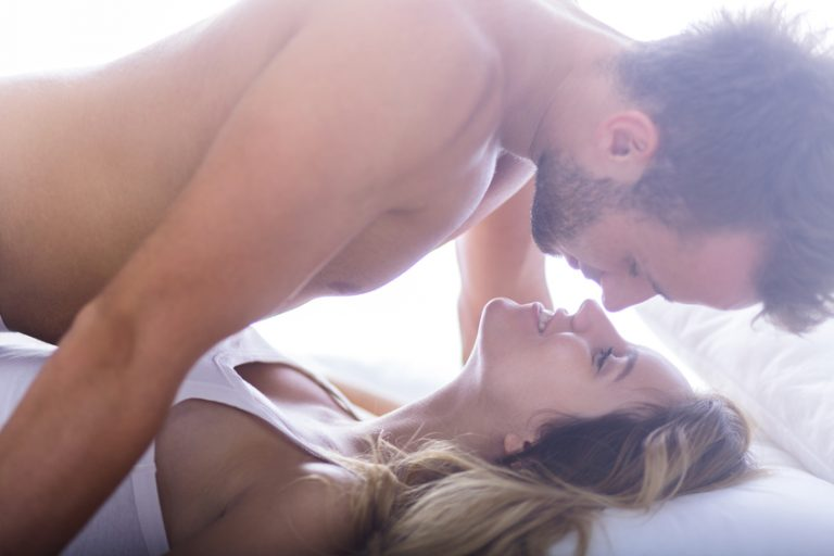 A sexy couple in bed, proving that nice guys get more sex