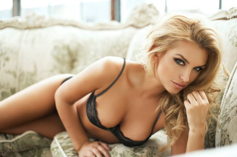 Sexy Sweden: a blonde woman in lingerie flirts with the camera