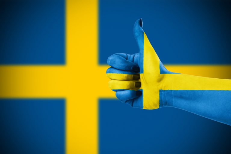 A thumbs up in front of the Swedish flag, approving of Sweden's favourite porn