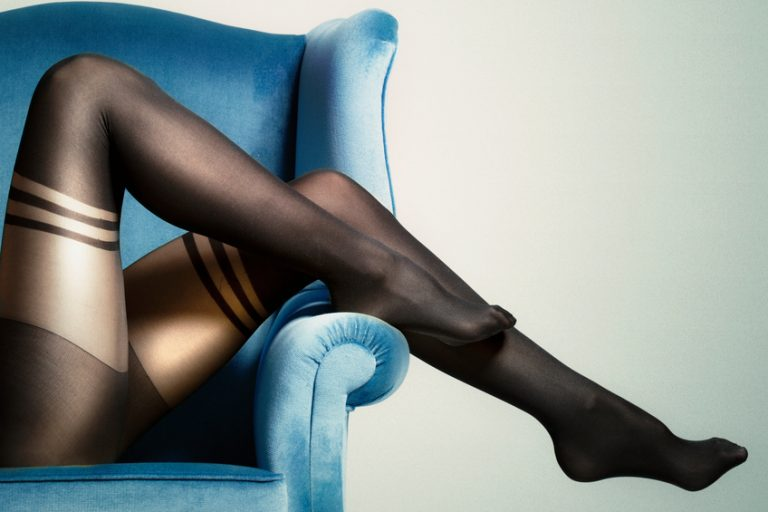 Sexy legs in stockings represent dirty sex