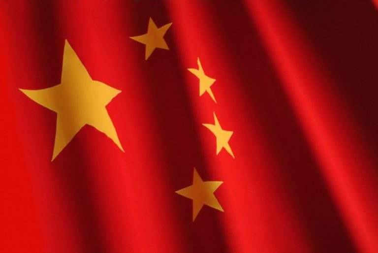 Chinese flag. Red, big yellow star on the left, four smaller stars next to it