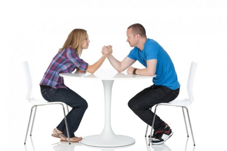 Man and woman in an arm wrestling match