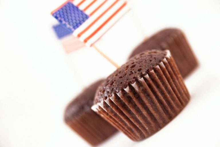 Chocolate cakes with the American flag sticking out of them