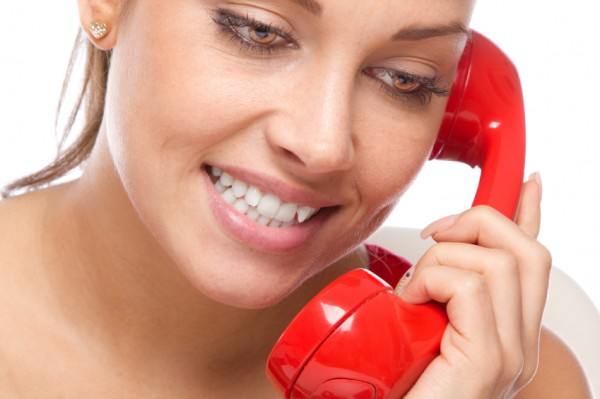 Woman on red telephone