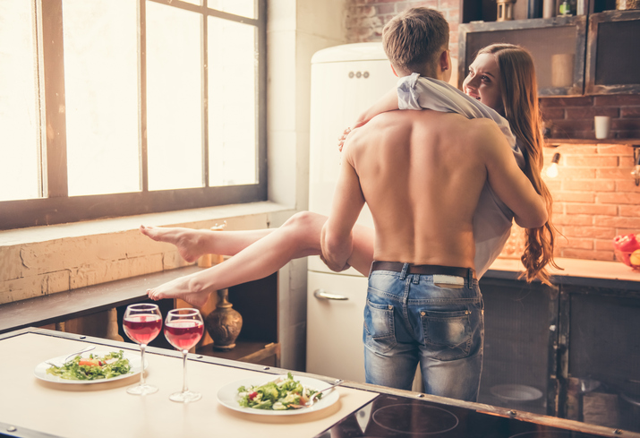 Couple having sex in the kitchen