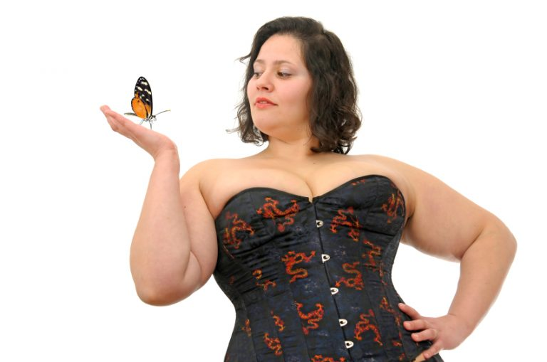 Beautiful large woman with butterfly isolated in white