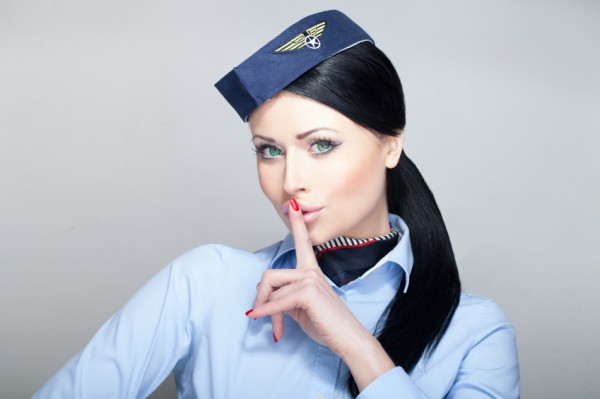 Attractive young woman stewardess flight attendant with green eyes