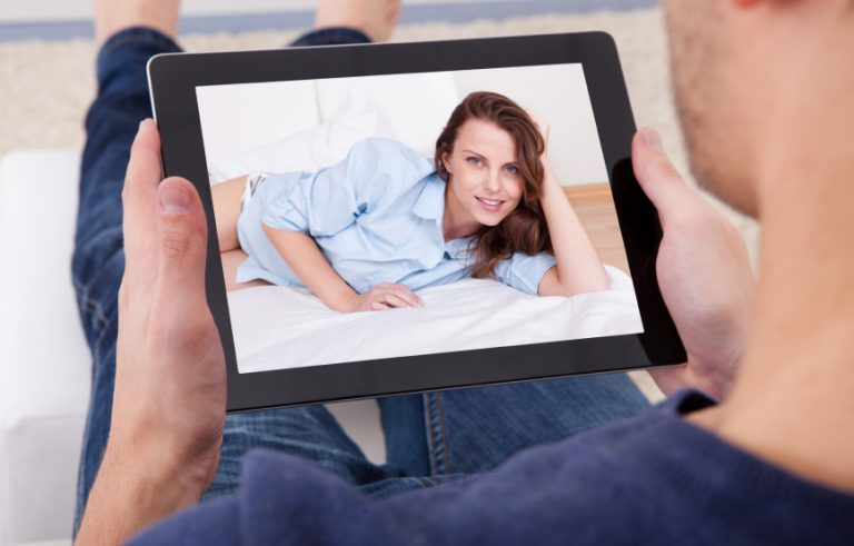 Close-up Of A Man Video Chatting With Young Woman