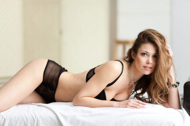 Beautiful lady in sexy lingerie lies in bed