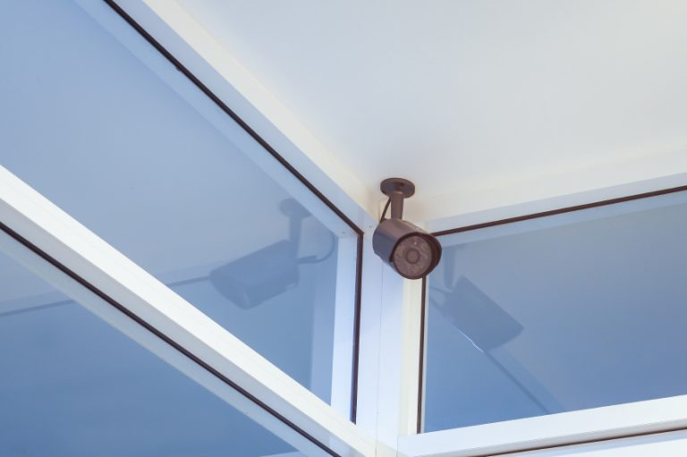 cctv camera security on wall background in room for safety concept