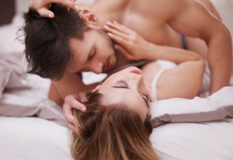 A couple in bed trying some kinky sex positions