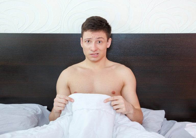 Impotent man worrying about his penis and erection failure , Surprised young man havingtrouble with potency and prostate