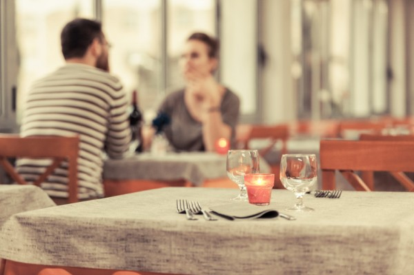 Romantic Young Couple at Restaurant