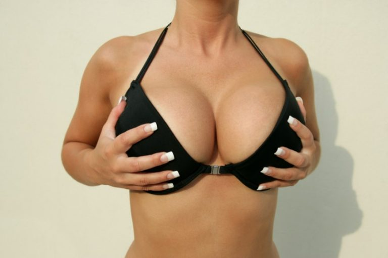 Woman with huge boobs in black bra